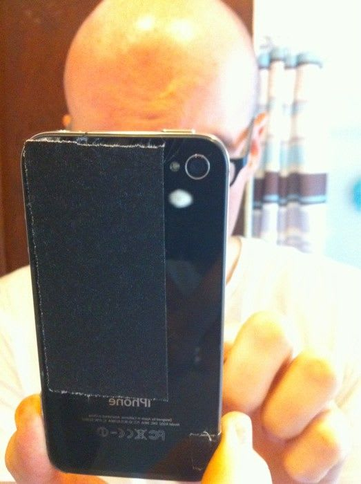 One way to deal with a broken glass on the back of an iPhone