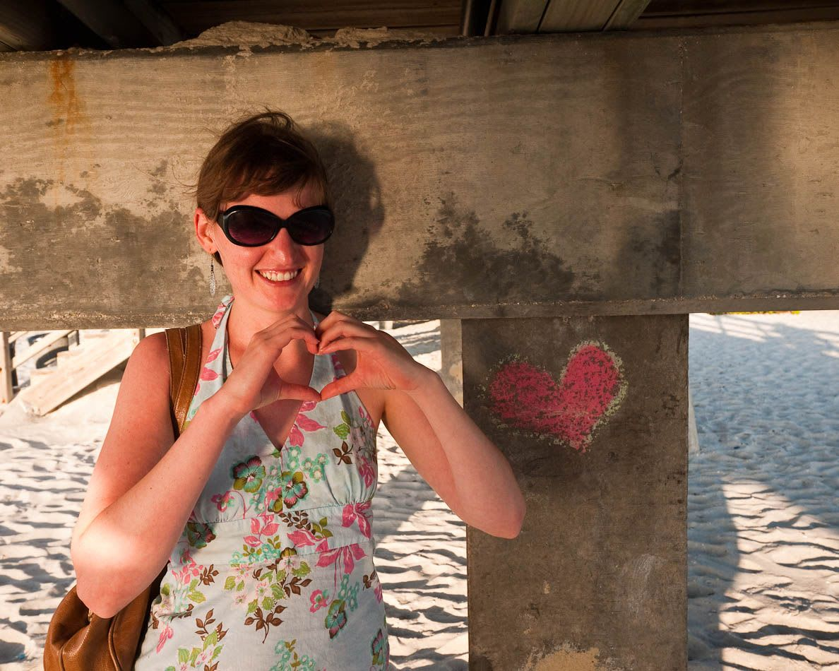 Kristin making a heart with her hands